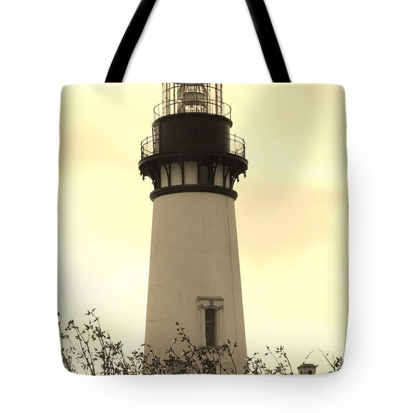 Tote Bag featuring the photograph Lighthouse Tranquility by Athena Mckinzie