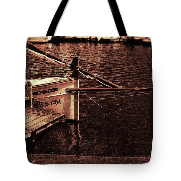 Tote Bag featuring the photograph Lil Kiss by Pedro Cardona