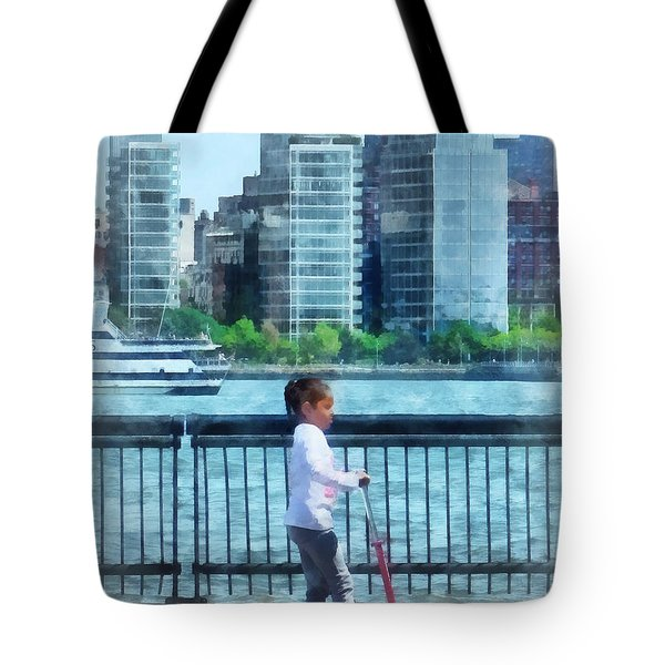 Little Girl On Scooter By Manhattan Skyline Tote Bag by Susan Savad