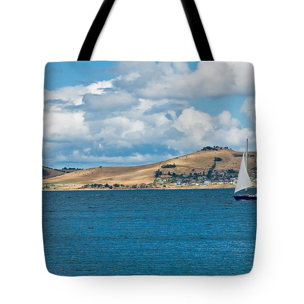 Luxury Yacht Sails In Blue Waters Along A Summer Coast Line Tote Bag by U Schade