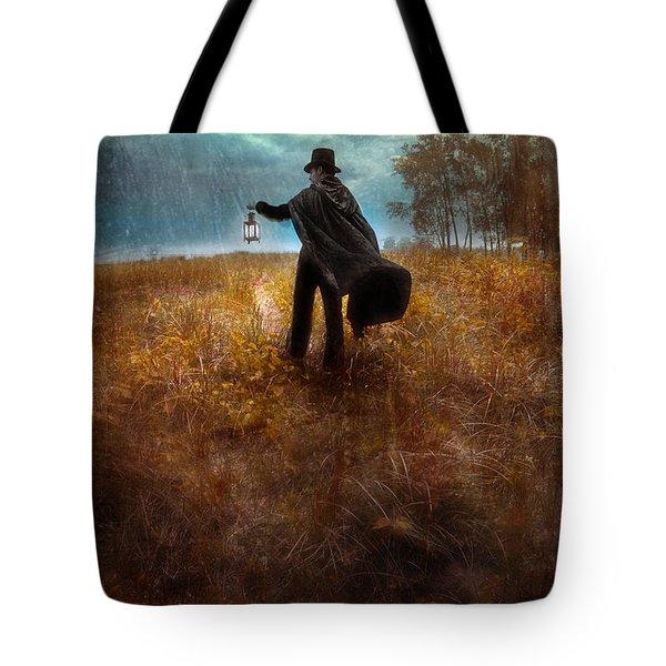 Man In Top Hat And Cape Walking In Rain Tote Bag by Jill Battaglia