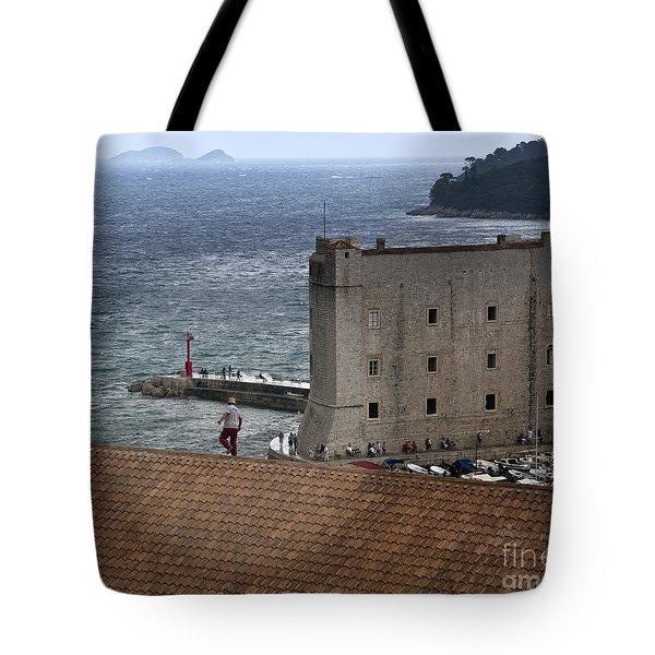 Man On The Roof In Dubrovnik Tote Bag by Madeline Ellis