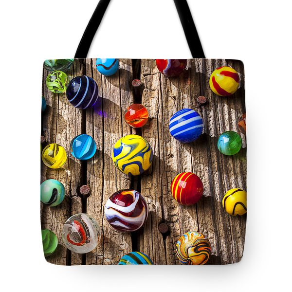 Marbles On Wooden Board Tote Bag by Garry Gay