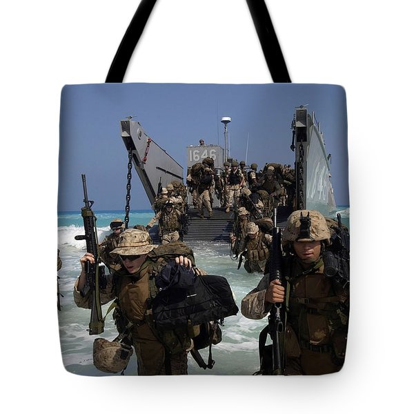 Marines Disembark A Landing Craft Tote Bag by Stocktrek Images