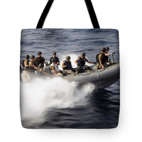 Members Of A Visit, Board, Search Tote Bag by Stocktrek Images