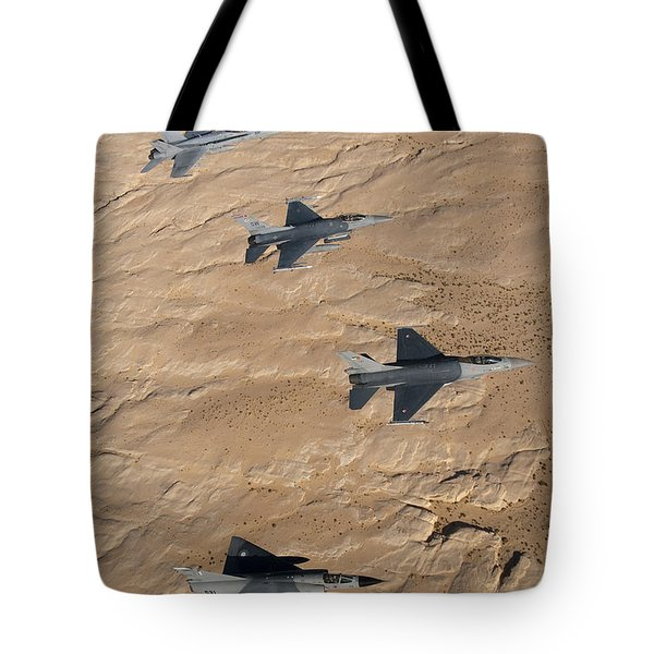 Military Fighter Jets Fly In Formation Tote Bag by Stocktrek Images