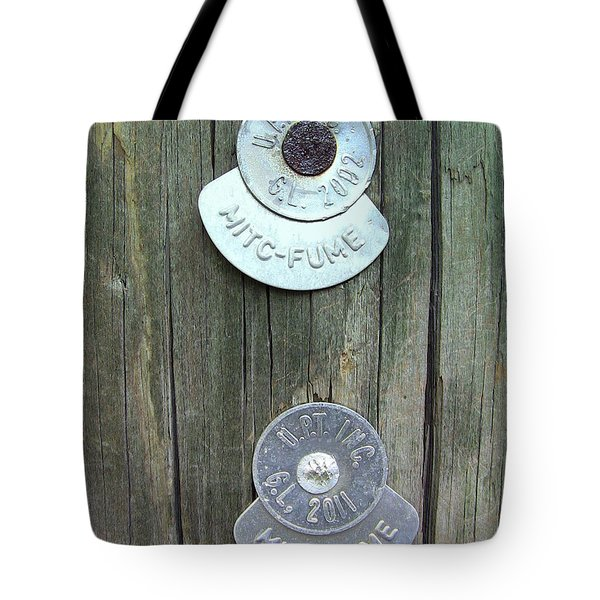 Tote Bag featuring the photograph Mitc Fume Tags On Light Pole by Renee Trenholm