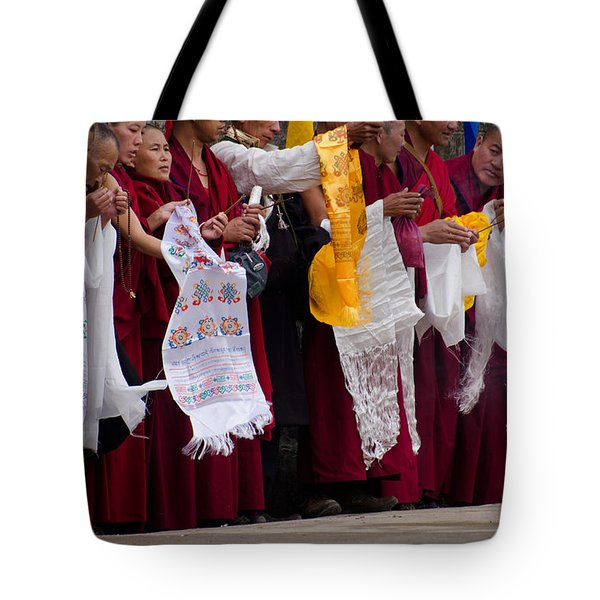 Tote Bag featuring the photograph Monks Wait For The Dalai Lama by Don Schwartz