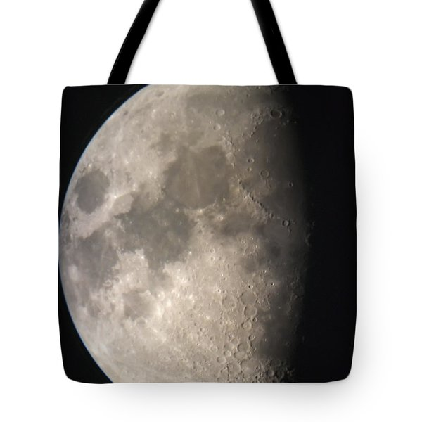 Tote Bag featuring the photograph Moon Against The Black Sky by John Short
