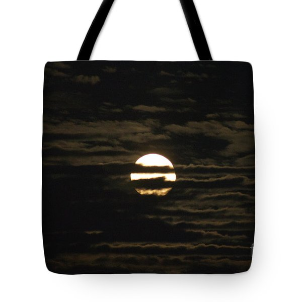 Tote Bag featuring the photograph Moon Behind The Clouds by William Norton