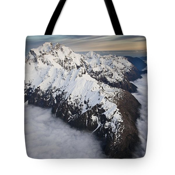 Mount Tutoko At Dawn In Fiordland Np Tote Bag by Colin Monteath