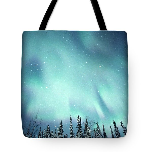 Northern Lights Over Snow Covered Tote Bag by Robert Postma