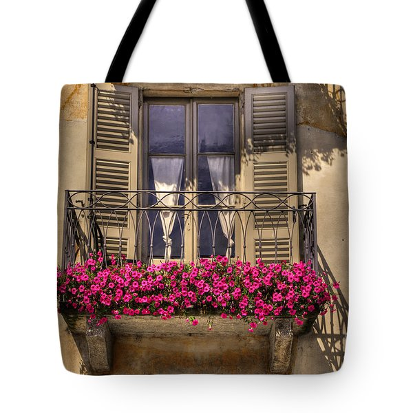 Old Balcony With Red Flowers Tote Bag by Mats Silvan
