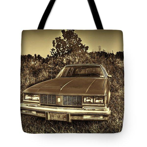 Old Car In Field Tote Bag by Dan Friend