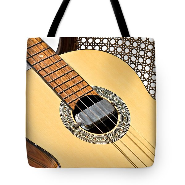 Old Guitar In A Chair Tote Bag