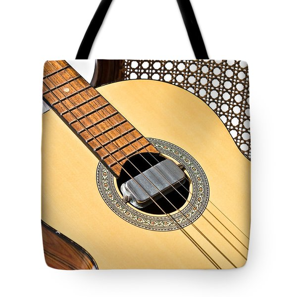 Tote Bag featuring the photograph Old Guitar In A Chair by Susan Leggett