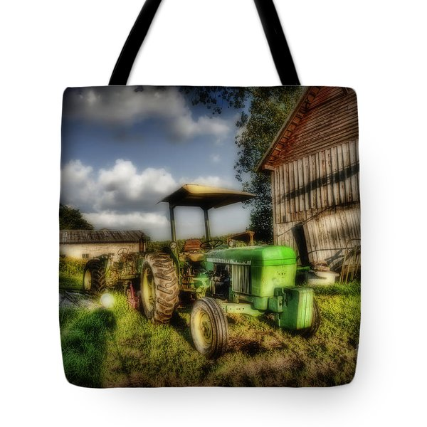 Old Tractor In Field By Barn Tote Bag by Dan Friend
