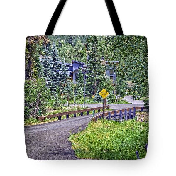 One Lane Bridge - Vail Tote Bag by Madeline Ellis