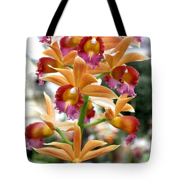 Tote Bag featuring the photograph Orange Orchids by Debbie Hart