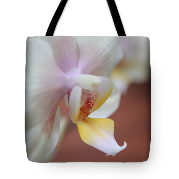 Tote Bag featuring the photograph Orchid II by Kelly Hazel