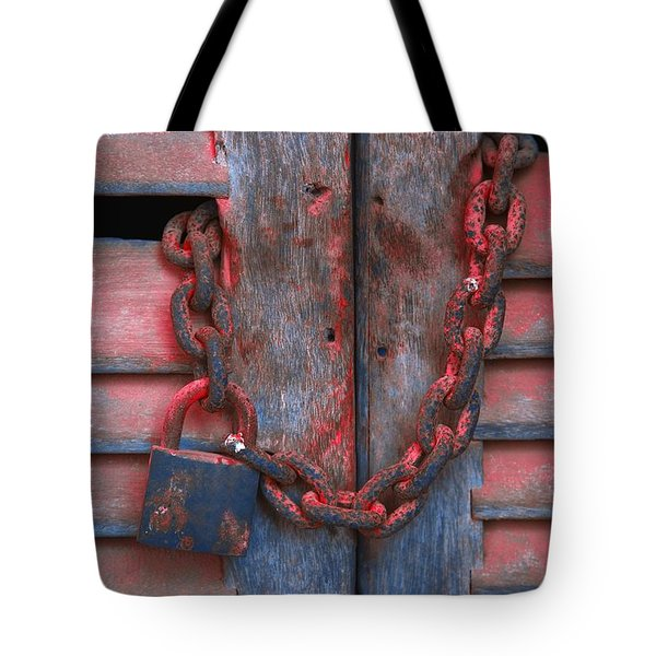 Padlock And Chain On Wooden Door Tote Bag by Carson Ganci