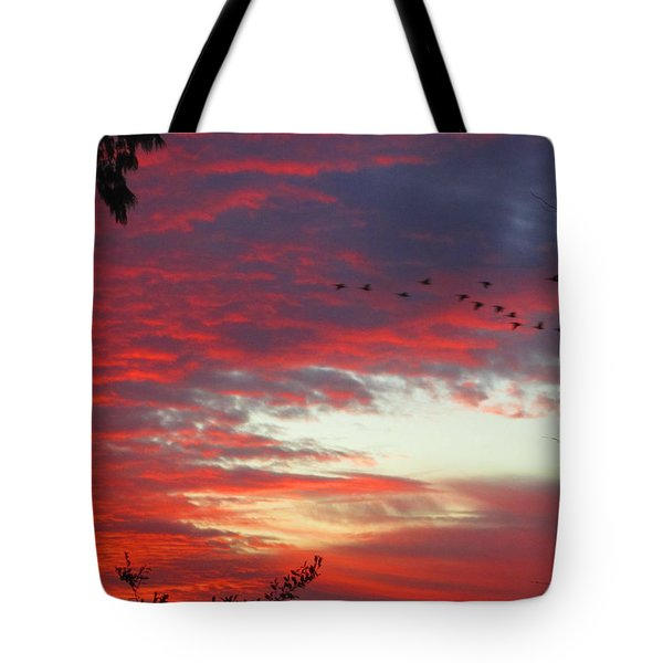 Papaya Colored Sunset With Geese Tote Bag by Kym Backland