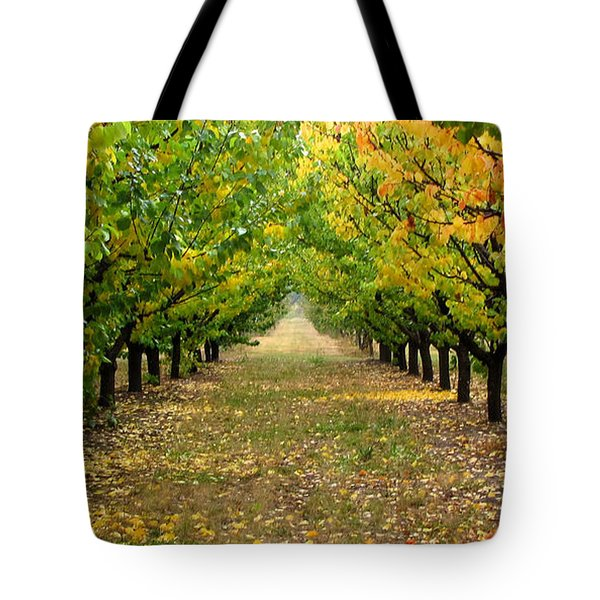 Tote Bag featuring the photograph Pear Orchard by Katie Wing Vigil