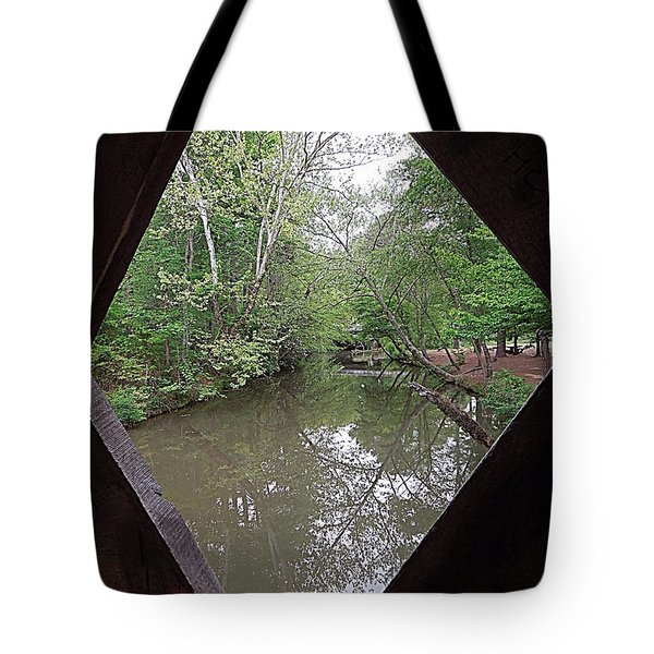Tote Bag featuring the photograph Peering Out by Renee Trenholm