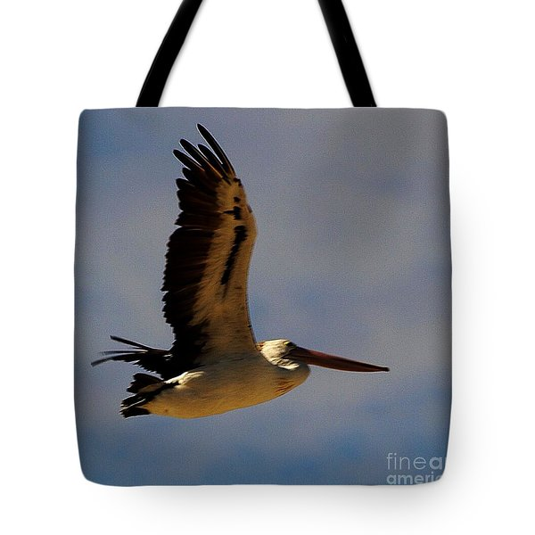Tote Bag featuring the photograph Pelican In Flight by Blair Stuart
