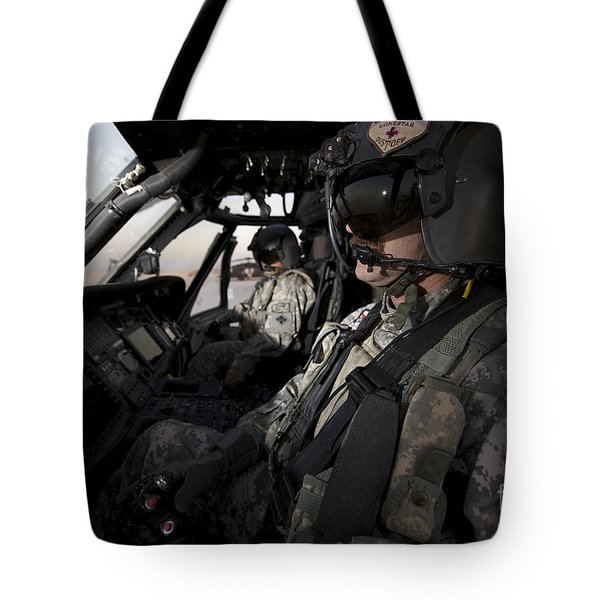 Pilot In The Cockpit Of A Uh-60l Tote Bag by Terry Moore