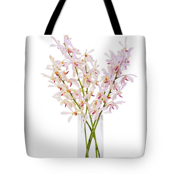 Pink Orchid In Vase Tote Bag by Atiketta Sangasaeng