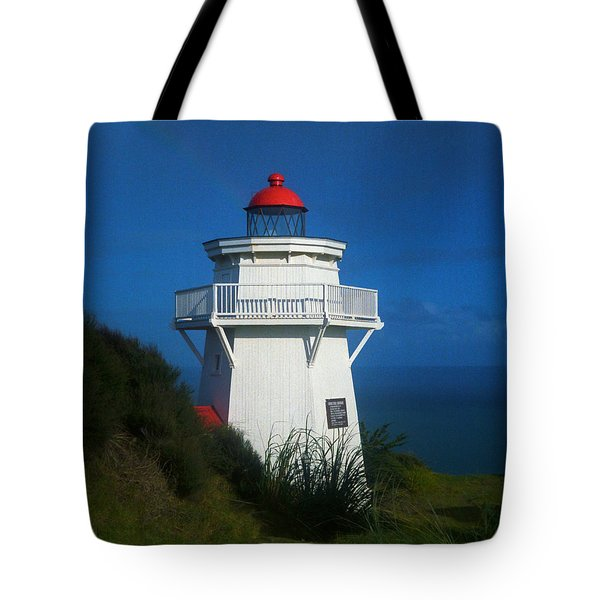Tote Bag featuring the photograph Pouto Lighthouse With Rainbow New Zealand by Mark Dodd