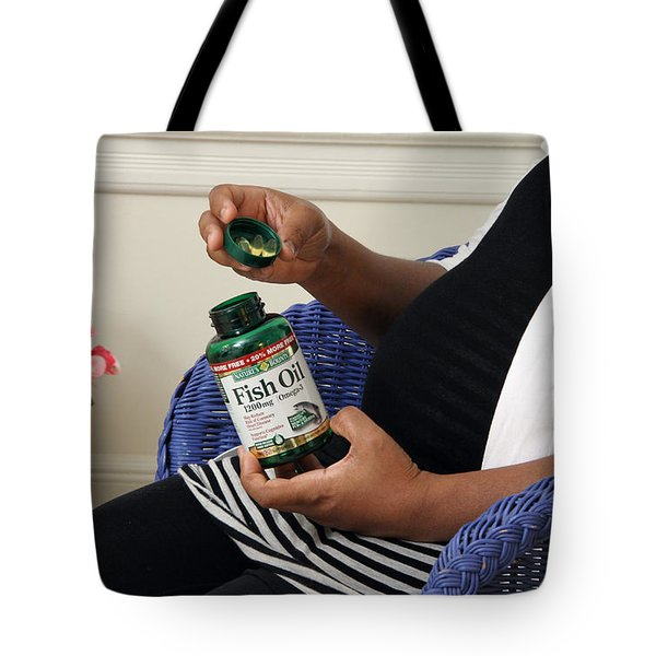 Pregnant Woman Taking Fish Oil Tote Bag by Photo Researchers