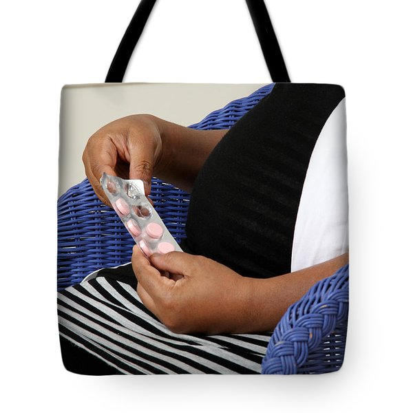 Pregnant Woman Taking Vitamins Tote Bag by Photo Researchers