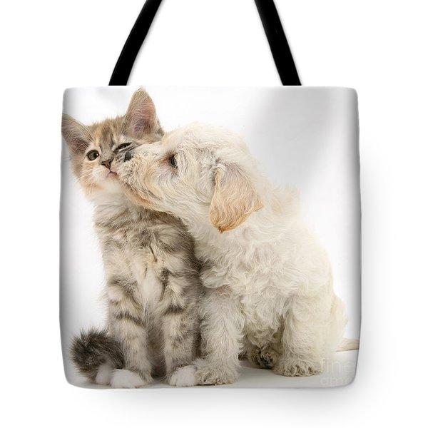 Puppy Nuzzles Kitten Tote Bag by Jane Burton
