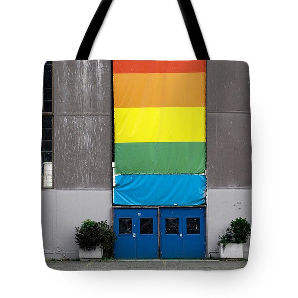 Tote Bag featuring the photograph Rainbow Banner Building by Kathleen Grace