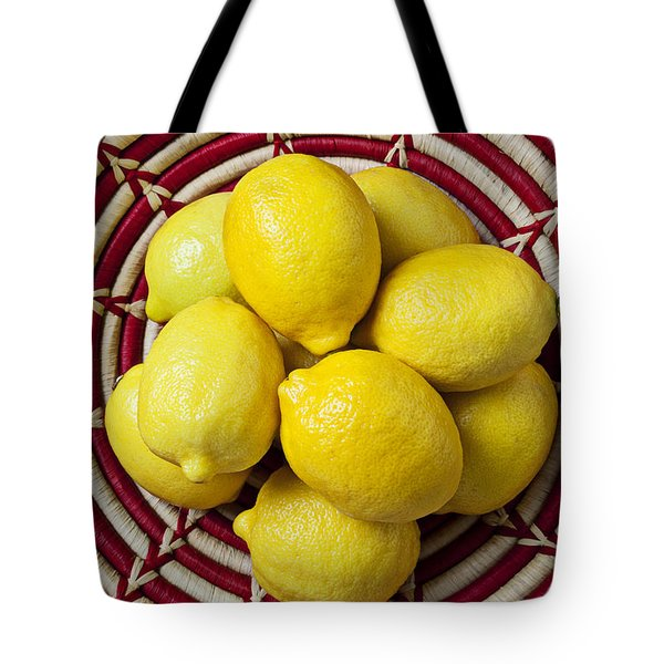 Red And White Basket Full Of Lemons Tote Bag by Garry Gay