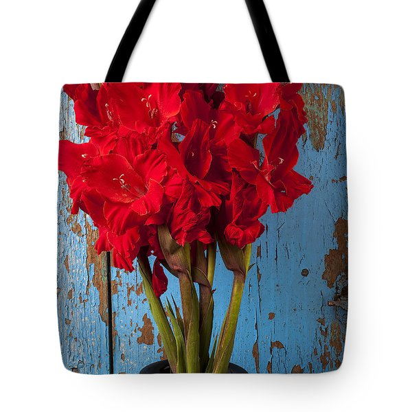 Red Glads Against Blue Wall Tote Bag by Garry Gay
