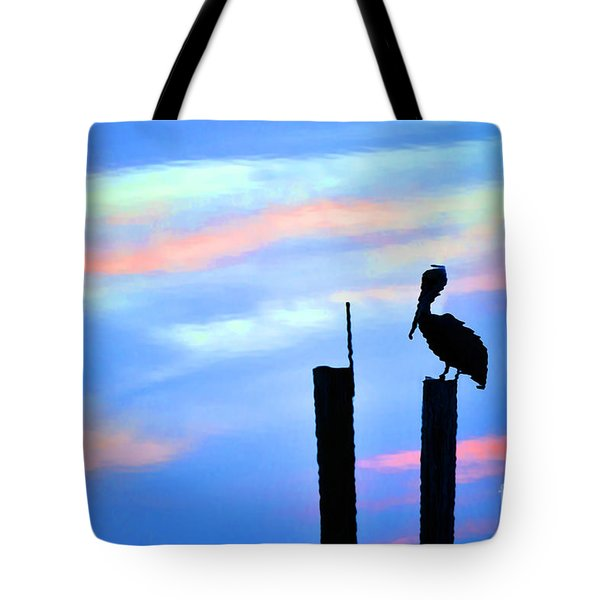 Tote Bag featuring the photograph Reflections In Water With Pelican by Dan Friend