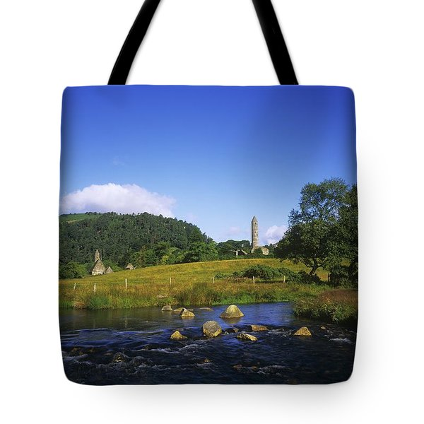 Round Tower And River In The Forest Tote Bag by The Irish Image Collection