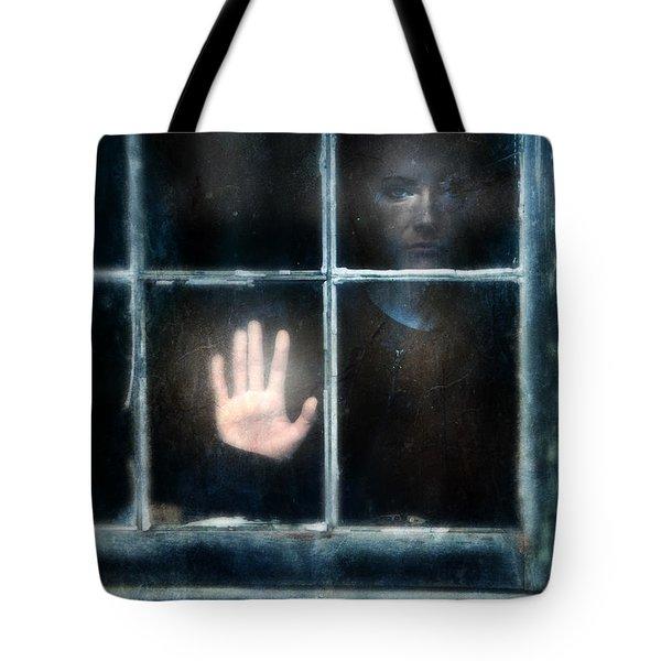 Sad Person Looking Out Window Tote Bag by Jill Battaglia