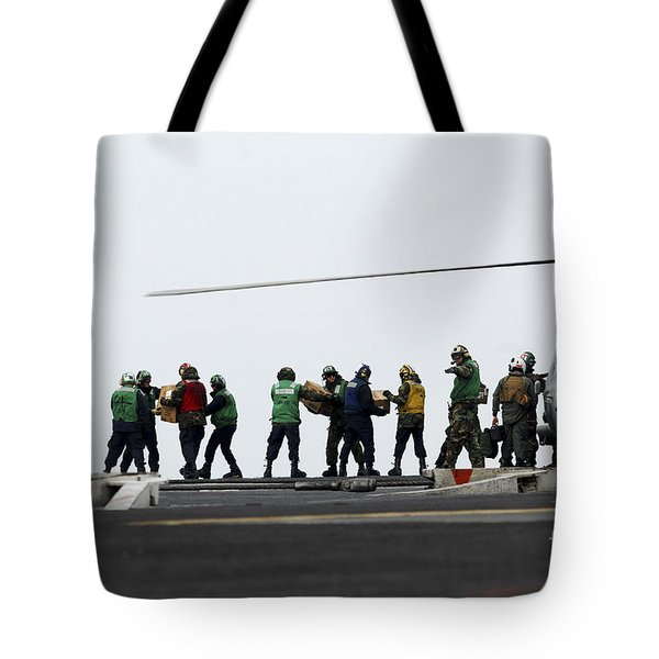 Sailors And Marines Load Supplies Onto Tote Bag by Stocktrek Images