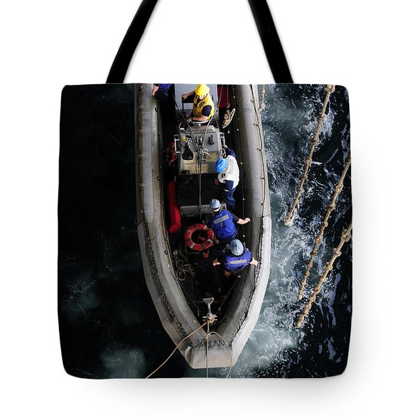 Sailors Conduct A Man Overboard Drill Tote Bag by Stocktrek Images