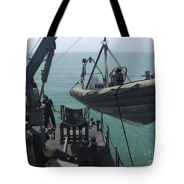 Sailors Lower A Rigid Hull Inflatable Tote Bag by Stocktrek Images