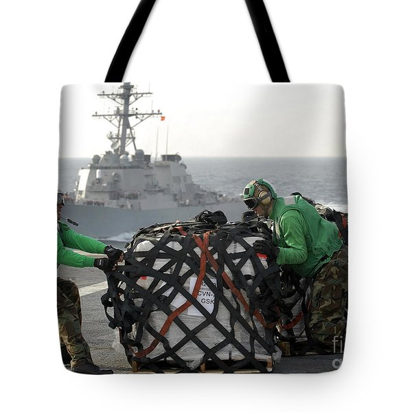 Sailors Move Supplies On The Flight Tote Bag