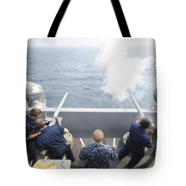 Sailors Perform A 21-gun Salute Aboard Tote Bag by Stocktrek Images