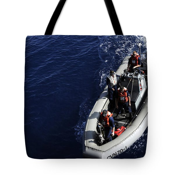 Sailors Stand Watch On A Rigid-hull Tote Bag by Stocktrek Images