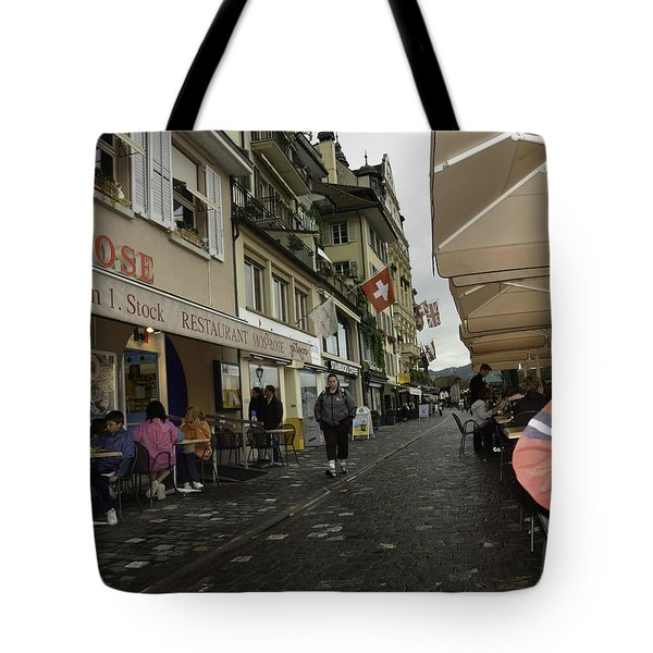 Seated In The Cafe Along The River In Lucerne In Switzerland Tote Bag by Ashish Agarwal