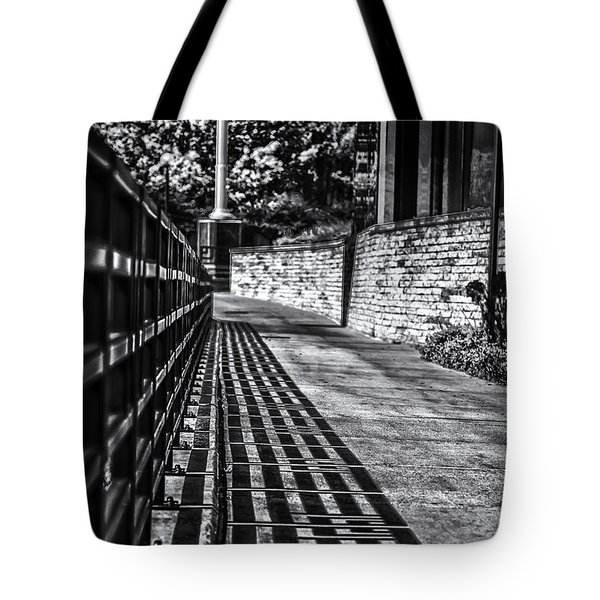 Tote Bag featuring the photograph Shadow Walk by Tom Gort