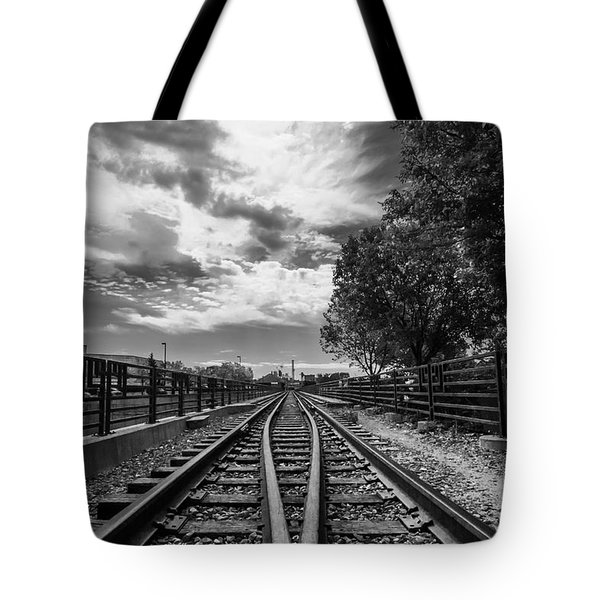 Tote Bag featuring the photograph Silent Spur by Tom Gort